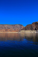 White Low Water Level Strip On Red Cliffs Of Lake Mead Entering Hoover Dam.Lake Above The Hoover Dam At Lake Mead National Recreation Area.Lake Mead At The Lake Mead National Recreational Area Near Bo
