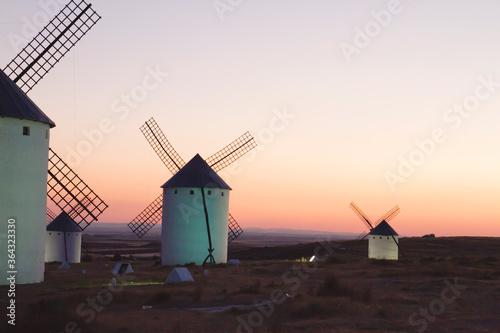 sunset with old windmills Castilla la Mancha, Spain