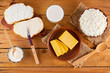 canvas print picture - Various dairy products. Milk, cottage cheese, hard cheese and sour cream in a rustic style. Bread with cream cheese on a wooden boards. Top view