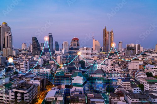 Valokuva Market behavior graph hologram, sunset panoramic city view of Bangkok, popular location to achieve financial degree in Asia
