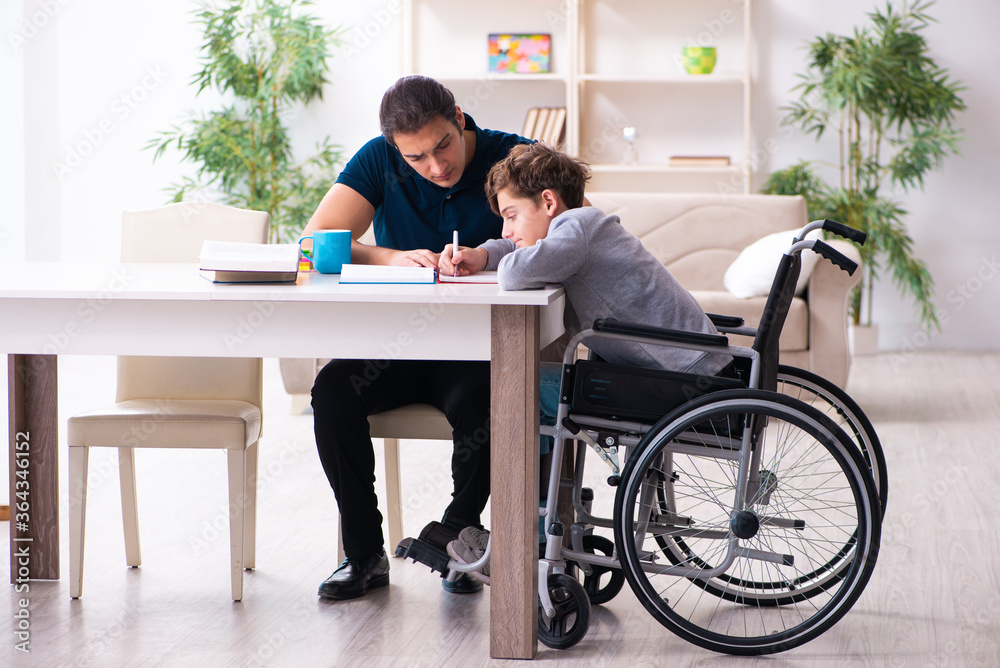 Fototapeta Father and disabled son in education concept