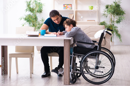 Father and disabled son in education concept Canvas Print