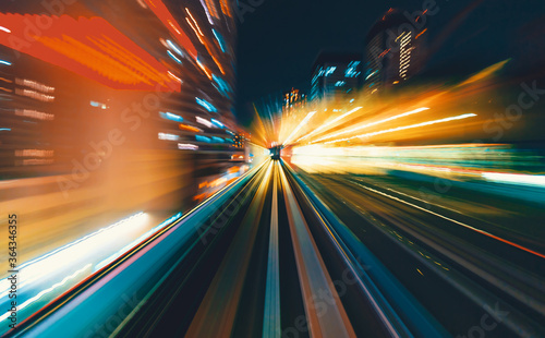 Fototapeta Abstract high speed technology POV train motion blurred concept from the Yuikamome monorail in Tokyo, Japan obraz