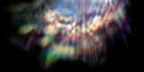 Fototapeta Rainbow - Lens flare effect on black background. Abstract Sun burst, sunflare for screen mode using. Sunflares nature abstract rainbow colourful backdrop, blinking sun burst, lens flare optical rays.