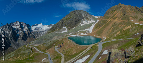Mountain lake for making snow in winter on the moutains around Solden, Austria, in the summer.