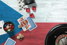 Czech Republic Casino Theme. Aces In Poker Game, Cards And Chips On Red Table With National Wooden Flag Background. Gambling And Betting.