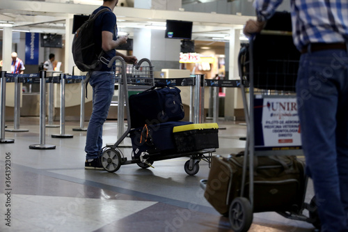 salvador, bahia / brazil - september 22, 2017: passengers are seen poking cart with suitcase in the lobby of the airport of the city of Salvador Fotobehang