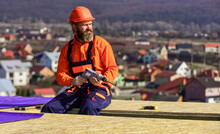 Roofer Constructing Roof. Man ...