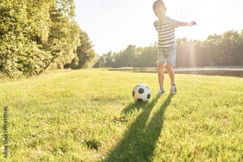 Fototapeta                                Boy about to gain a goal in soccer obraz