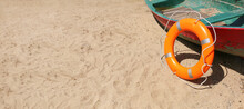Lifebuoy Ring Near Boat Outdoors With Space For Text