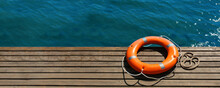 Lifebuoy Ring On Sea Pier With...