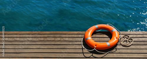 Lifebuoy ring on sea pier with space for text Tapéta, Fotótapéta