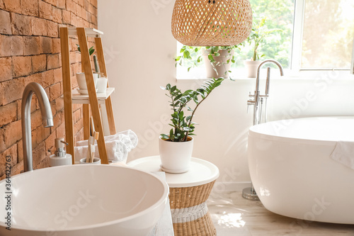Stylish interior of modern bathroom with clean towels Fototapeta