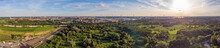 Aerial Sunset View On Antwerp North Area, With City And Harbor In Far Distance, Nature Park Oude Landen In Foreground