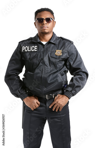 Fotografija Aggressive African-American police officer on white background