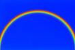 canvas print picture - arc-en-ciel  sur fond de ciel bleu