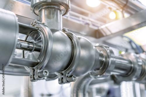 фотография System of shutoff valves and metal pipelines.
