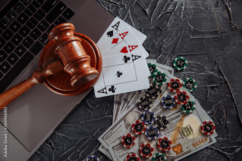 Judge wooden gavel and playing cards on computer keyboard, legal rules for online gambling concept Canvas Print
