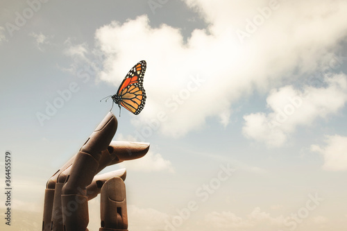 surreal encounter between a wooden hand and a colorful butterfly Canvas Print