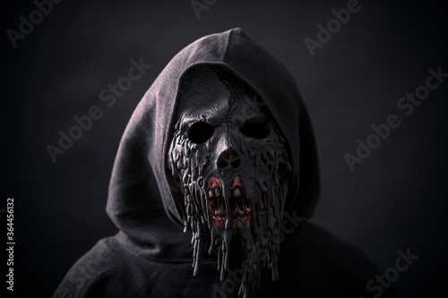 Scary figure in hooded cloak with mask Fotobehang
