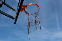 Basketball Hoop With A Red Ring Against A Cloudless Warm Summer Sky