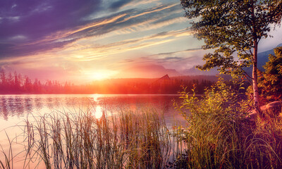 Fototapeta Vintage Fantastic views of the Mountain Lake under sunlight. Dramatic and picturesque scene. Colorful Autumn landscape at Sunset . Impressive Nature Scenery. Artistic picture. Wild area. Strbske Pleso.