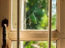 A Hole From Broken Glass Window Of A House.