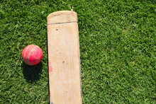 Cricket Ball And Bat On The Gr...