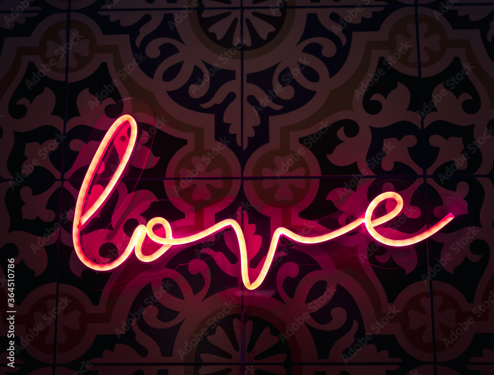 Fototapeta Love. Neon sign letter word Love in bright red colours glow in the dark.