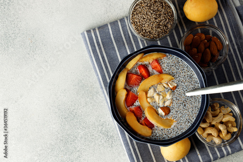 Cuadros en Lienzo Bowl of chia poudding with pieces of apricots and strawberry