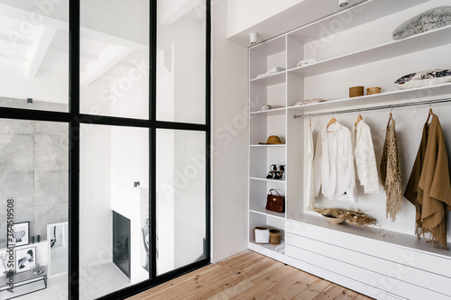 Fototapeta White and large wardrobe closet in dressing room