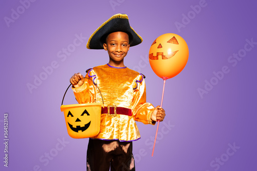 Little cute black boy in Halloween costume show smiling and standing over purple Slika na platnu