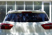Back Window Of White Car Parke...