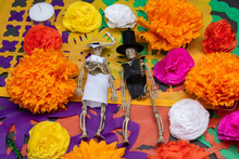 Bride And Groom Skeletons With Colorful Flowers On Cut Paper. Day Of The Dead Decoration