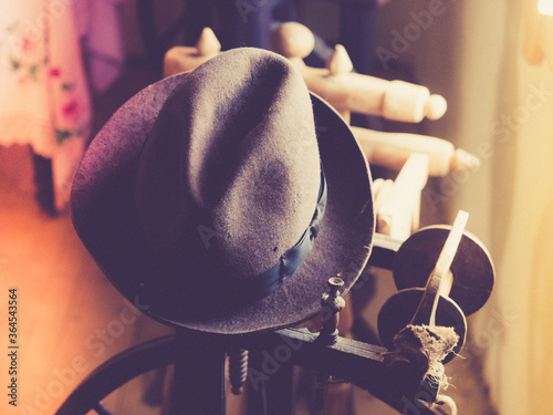 Fototapeta Vintage hat of wool in an authentic antique historical environment