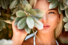 Portrait Of A Blonde With Natural Beauty Among The Leaves Of Tropical Trees. Spa And Pleasure
