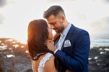 Newlywed Couple Hugging At Sea...
