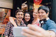 Cheerful Friends Taking A Selfie