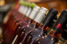 Close-up Of Filled Bottles Of ...