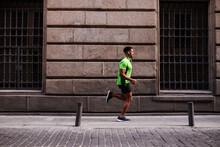 Young Man Running Through The ...