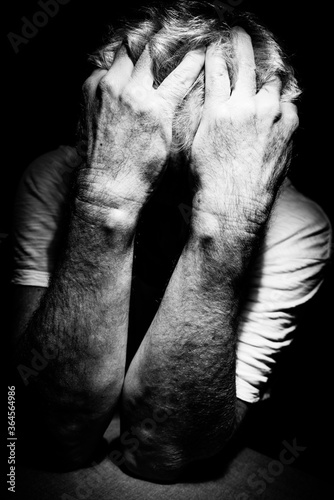 Middle aged man locked in painful anguish or mental health issues alone face cov Canvas Print