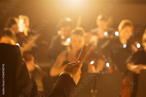 Conductor leading orchestra Wallpaper Mural