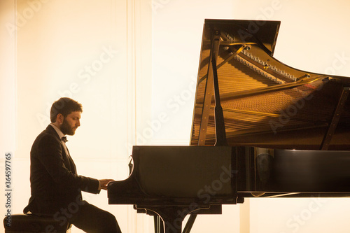 Fototapeta Silhouette of pianist performing