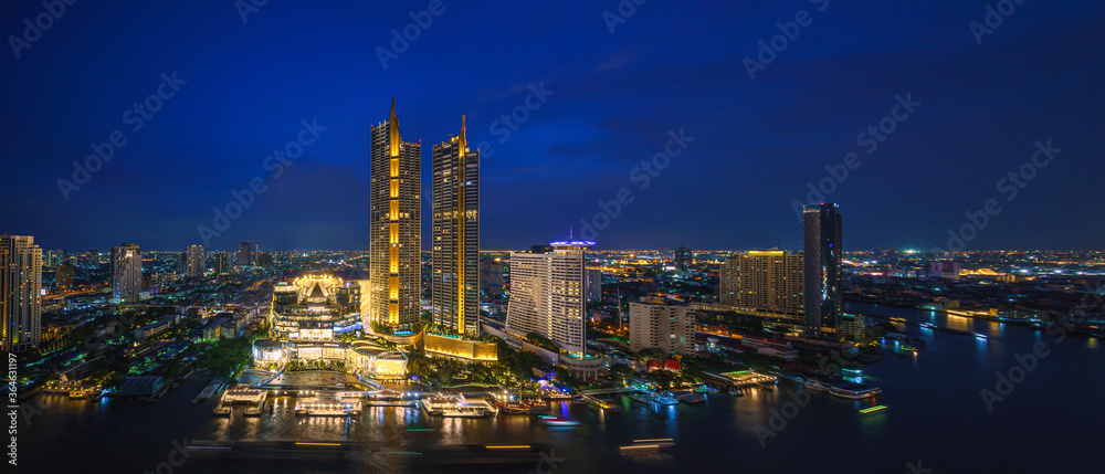 Fototapeta perspective night scenery of Iconsiam is a mixed-use development on Chao Phraya River banks in Bangkok, It includes one of the largest shopping malls in Asia and Magnolias hotels and residences