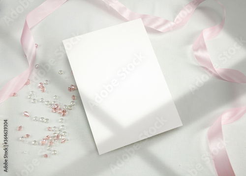 Obraz Invitation Mockup. Top view blank card on white background and window shadow with clipping path. - fototapety do salonu