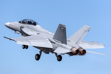 F/A-18F Super Hornet Multirole Fighter Aircraft Taking Off Into A Blue Sky.