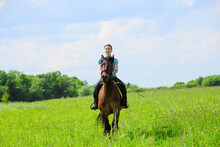 The Caucasian Horsewoman Is Ri...