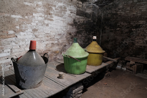 Papel de parede old glass demijohns for wine with dust abandoned