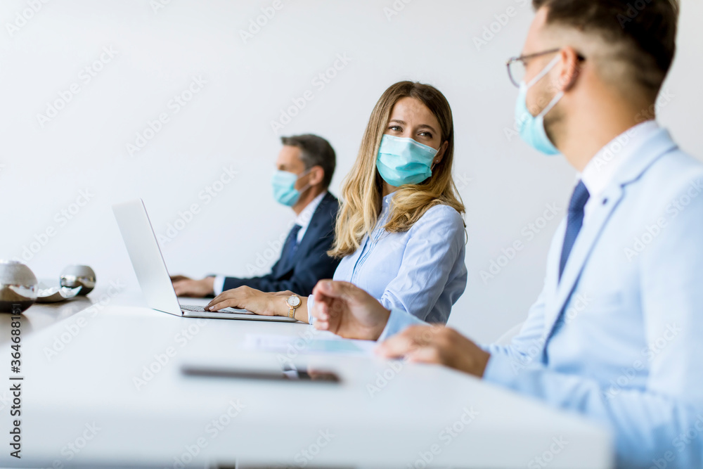 Fototapeta Group of business people have a meeting and working in office and wear masks as protection from corona virus