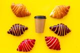 Fototapeta Kawa jest smaczna - Set of coffee with croissants - chocolate, berry, classic - on yellow table